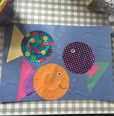 Fish made from cupcake cases, paper triangles and googley eyes