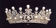A diamond and natural pearl belle epoque tiara, circa 1900. Designed as a series of seven 'lyre-shaped' diamond motifs, topped with diamond foliates,  and smaller diamond and button pearl clusters, all topped with upright, pear-shaped natural pearls, on a base of circular diamonds.