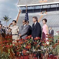 President Kennedy addresses the 2506 Brigade. Miami, Florida, Orange Bowl Stadium. L-R: Miami Mayor Robert King High,  Manuel Artime (saluting), former Cuban President Jose Miro Cardona, President Kennedy, Mrs. Kennedy.