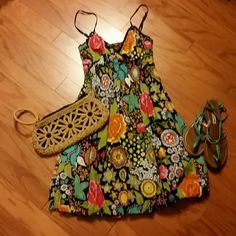 Fun Sundress Spaghetti strapped, bubble hem, adorable floral sundress. Goes just about to the knee. Elastic smocked waist, fit is very forgiving. It is low cut, you could easily pair it with a black cami for modesty. speed control Dresses Midi