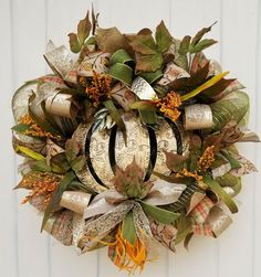 This beautiful fall wreath is elegant in its design, and subtle in its colors, which makes for the perfect seasonal wreath!