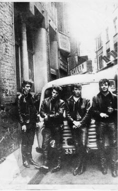 THE 'ORIGINAL' BEATLES IN LEATHER OUTFITS OUTSIDE CAVERN
