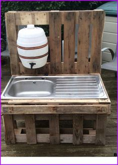 """Before plumbing: kitchen & outhouse sink water. outdoor stainless steel sink in pallet wood frame with dispenser water bottle make something like this alongside the shed area - fill tank with rainwater I like the idea to add a """"water supply"""" for the k"""
