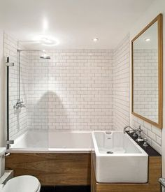 White subway tiles in a small bathroom are crisp, classic and space-enhancing, and look particularly on trend with grey grout.