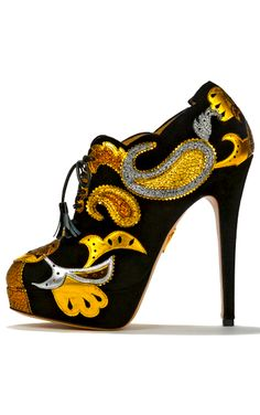 Orient Express by Charlotte Olympia is a dazzling lace-up ankle bootie in vibrant peacock suede kidskin. This silver and gold delicately hand-stitched paisley leather detailing creates an exquisite ankle boot to surpass all ankle boots.#black #gold