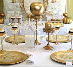 I spraypainted plain fake fruit & plastic spiders from Dollar Tree gold to create this Snow white witch gold & bling dining table for less!