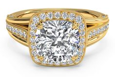 This extraordinary designer engagement ring contains a halo setting surrounding your center diamond, pave diamonds decorating the shank on all three outer sides, beautiful milgrain detailing on the 18k gold yellow band, and even surprise diamonds on the basket holding your center stone. This ring is meant to be set with a cushion cut diamond but can also be set with a traditional round diamond (we prefer the cushion cut for this ring though!).
