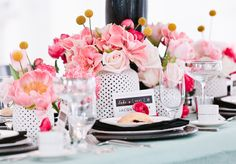 Pretty pink centerpieces to set off the black and white theme. Amaryllis, roses, peonies, craspedia (Billy Balls)