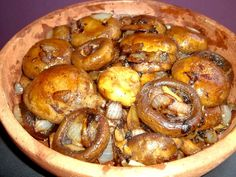 """Baked Mushrooms with Sulguni Cheese - baked in butter in traditional Georgian clay """"ketsi"""" dishes (Georgian: კეცი) these mushrooms filled with melted Sulguni cheese are amazing! See our Georgia About blog for traditional Georgian recipes: http://georgiaabout.wordpress.com/2012/08/20/about-food-make-your-own-supra-georgian-feast-with-our-step-by-step-georgian-recipes/"""