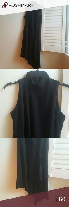 WHBM Black Mock Neck Dress Sleeveless dress with mock neck. Stretch ponte knit. Asymmetrical hemline. Dramatic draping in front with short slit. Hidden zipper up back with large keyhole opening. Hook and eye closures at neck. Lined bodice. White House Black Market Dresses
