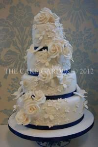 this cake, three tiers. like the cascade of butterflies and roses.