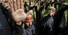 Lebanese Hezbollah supporters gesture as they march during a religious procession to mark Ashura in Beirut's suburbs
