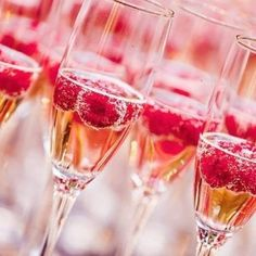 Champagne with raspberries- perfect drink to tie in with gold and pink theme, Meesh! But raspberries are summery and you don't like them... But it looks pretty! :D
