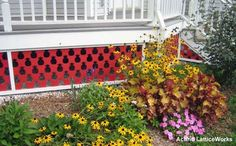 The red pineapple pattern on this vinyl lattice looks charming.  on Front-Porch-Ideas-and-More.com #decks