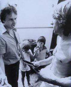 Gilles Villeneuve & Jacques Villeneuve talking with Jacques Laffite