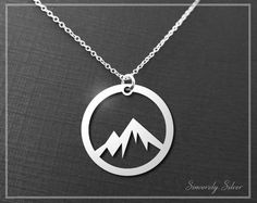 Mountain necklace, a cute outdoor necklace cut out of sterling silver. It is hung on a sterling silver chain.  All of our premium necklaces are precision laser cut out of sterling silver (.925 silver). *If shopping around, please be sure to ask how each piece is produced. Many other products are made with CNC mills which are far less costly but are unable to produce the fine detail that comes from laser cut material*  Product: 20 Gauge Height/width: 20mm 18 sterling silver chain…