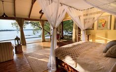 Tongabezi is a luxury safari lodge near Victoria Falls in Zambia. This award winning lodge is a romantic hideaway on the banks of the Zambezi River. Southern Province, Dog House Bed, Village House Design, Safari Holidays, Victoria Falls, Road Trip Hacks, Best Resorts, Beautiful Places To Travel, Travel And Leisure