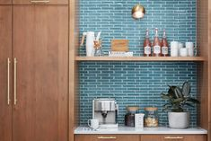 There's that teal color from the front door again! I can't overstate how much my sister loves this color, and I liked the idea of surprising her with it in little sections throughout the house. When we found this backsplash, I immediately knew it was the one.