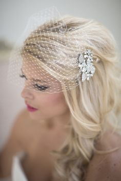 Love this hair- I don't think a birdcage veil would suit me, but the comb in my hair with it just down and curly like that... Thoughts? I've been thinking updo this whole time, but...
