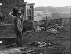 """French journalist Jean Marin views the body of a 4-year-old, murdered with163 other Belgian civiliansby the German6th SS Panzer Army Kampfgruppe """"Peiper"""", part of the 1st SS Panzer Division Leibstandarte SS Adolf Hitler, led by SS-Standartenführer Joachim Peiper.During the heavyfighting ofthe Battle of the Bulge,Peiper instructed his soldiers to kill civilians in and around Stavelot, Parfondruy and RenardmontinBelgium who he suspected of harboring or aiding Allied troops..."""
