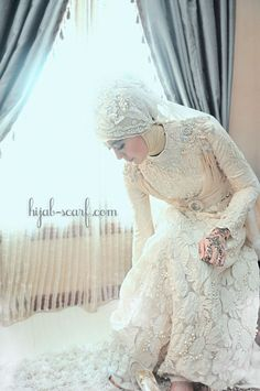 White wedding dress designed by Icha herself and her mom, made from lace and swarovski.  Hijab style by Irna La Perle.