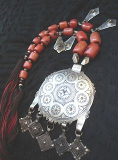 Africa | Old Berber necklace ~ Nine Moons ~ from south Morocco. Silver, madrepore coral and niello decorations. ca. early 20th century. This talisman of fertility represents the nine moons of human gestation. | 389$