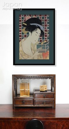 A charming Utamaro (1750-1806) Japanese hand pressed woodblock reprint, titled, 'Beauty and an Insect Cage.' The young beauty smiles as she reaches into an insect cage used to hold fireflies in the summertime, her paulownia patterned summer kimono slipping off her shoulder. Her hair is pulled back into a smooth bun adorned with a comb, hairpins, and ribbons. #japanesewoodblock #utamarowoodblockprint #japaneseartprint #beautyandinsectcage #ukiyoe by #JapanDownUnder on Etsy Wooden Display Stand, Lucky Symbols, Traditional Japanese House, Japanese Furniture, Wooden Flowers, Wooden Chest, Flower Stands, Wooden Jewelry Boxes, Seasonal Flowers