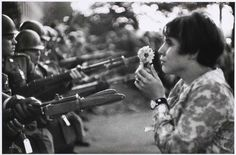 "Marc Riboud, 1967 | This is among the most celebrated anti-war pictures. Shot in Washington, D.C. Riboud said of the photo, ""I had the feeling the soldiers were more afraid of her than she was of the bayonets."""