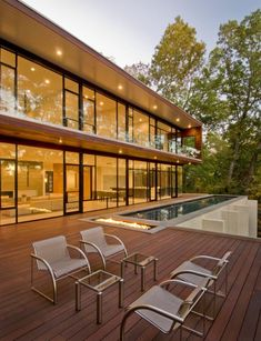 Robert Gurney Architect completed the design and development of a two-level modern home located in Glen Echo, Maryland, USA. Built on the remains of a former house on the lot, Wissioming Residence is one of the few contemporary abodes in its region. W Hotel, Residential Architecture, Modern Architecture, Cool Fire Pits, Fire Pit Seating, Property Design, Architectural Photographers, Beautiful Homes, Simply Beautiful