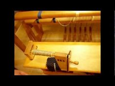 How to Weave on a Treadle Loom - Tying up the treadles...I would so do this if I had the room in my house for a loom like this