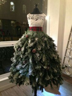 I love this beautiful twist on a Christmas tree using a dress form! It is simply gorgeous!