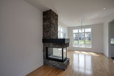 Example Of 3 Sided Peninsula Firepalce On Wood Floors 3 Sided Fireplace, Vented Gas Fireplace, Home Fireplace, Fireplace Remodel, Living Room With Fireplace, Fireplace Design, Living Room Decor, Fireplace Ideas, Fireplaces