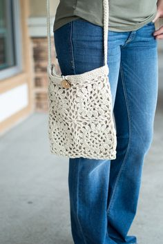 Crochet cross body purse with button loop closure