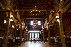 Maine barns can be dark...so lighting is very important for your wedding reception. Photo by @durginphoto