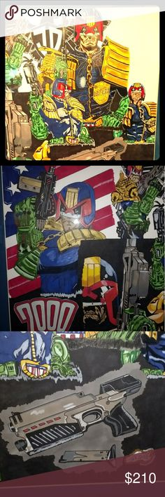 Hand drawn art by artist from the UK Jean - Paul Valintino a British artists drawing of Judge Dredd   cartoon with blue matting . The drawing  is 18x24 and 60 hours went into drawing it. He can draw any characters you request for yourself or your child. Jean - Paul Valintino Other