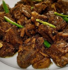 Lamb masala. This is a dry dish very commonly served as a side-dish or a dish on it's own. You can even try this recipe with warm baps. Adjust heat as per your preference.