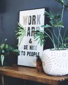 """Work hard and be nice to people."" Ain't that the truth! Thanks @schoolhouse for the reminder! It sits on our little plant bench right when you walk into the studio via @wideeyespaperco"