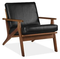MAYBE / YES - Featuring a solid wood frame with elegant angles and a loose back cushion, the Sanna leather chair evokes a mid-century feel. We updated the design to highlight a classic mix of materials.