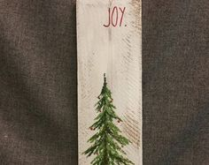 Pine tree Reclaimed white washed Wood Pallet Art, winter snow, Christmas Hand painted, upcycled, Wall art, Distressed  Original Acrylic painting on reclaimed Pallet boards. This unique piece is 36 x apprx. 12  This pine tree that is painted on a white-washed background, can be used for Christmas decorating and can be used all winter long! Perfect for that skinny wall space or just lean it against the wall.  All of my creations are made of reclaimed boards. They are hand painted and are made…