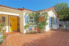 Love the yellow door and blue shutters!    Tour Craig Ferguson's Los Angeles Home for Sale : HGTV FrontDoor Real Estate