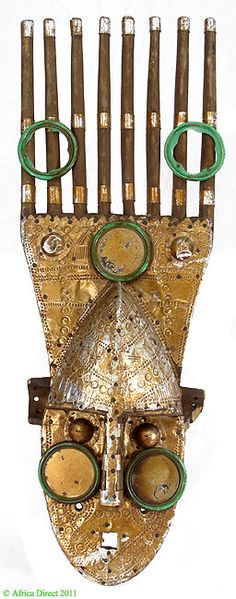 Africa |  Marka/Bamana Horned NTomo face Mask, Designed with Tin sheets and mirrors, from Mali |  Ca mid 20th century.