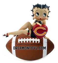 For Betty Boop with all the NFL team logos, go to: http://bettybooppicturesarchive.blogspot.com/2012/09/betty-boop-with-nfl-football-logos.html ~Or on Facebook~ https://www.facebook.com/media/set/?set=a.572965782717273.145289.157123250968197&type=1 - Betty Boop posing on a football with red heart and Chicago Bears logo #nfl