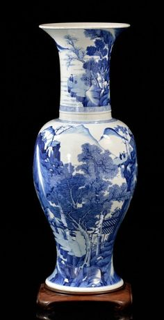 Grand Chinese Blue and White Yen-Yen Vase. Tall baluster form, vibrantly painted in blue and white with villages, fishing boat, mountains, waterfalls and scholar figures in a rocky landscape by riverbanks. Original wood stand.