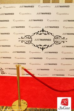 """DIY red carpet photo booth for wedding reception. """"Just Married"""" step and repeat."""