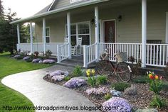 stamped concrete porch with white railing...this is what ours should hopefully looks - wish I could see the pattern of stamped concrete on this one better.