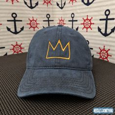 dd3eb88eed8 This soft-coated embroidered Navy Basquiat Crown hat is