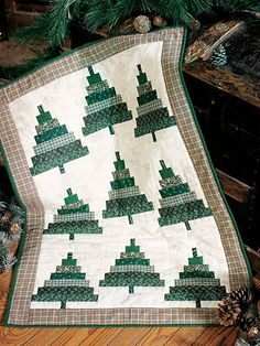 Quilting - Wall Quilt Patterns - Christmas Patterns Use pieced strips to cut the units to make this quick wall quilt. Size: 23 x Skill Level: Beginner Christmas Tree Quilt, Christmas Quilt Patterns, Christmas Placemats, Christmas Sewing, Christmas Crafts, Christmas Patchwork, Christmas Quilting, Christmas Wreaths, Big Block Quilts