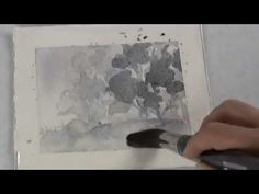 Learn how to do a vey simple watercolor painting of Trees in the Fog using only two colors