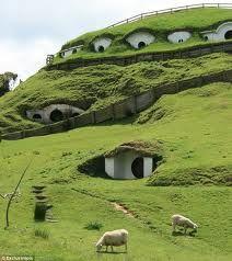 Green homes dot a rural hillside