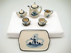 Delft Porcelain Miniature Tea Set Multiple Pieces. I have this exact one bought in Holland Mich.